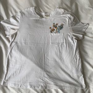 White tee with embroidered bird and flower